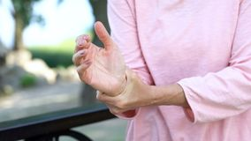 Mature woman feeling wrist pain, injury problem, healthcare concept, sprain. Stock photo royalty free stock images