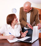 Mature woman filling questionnaire Royalty Free Stock Photo