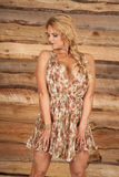 Mature woman flower dress hold down Royalty Free Stock Photos