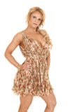Mature woman flower dress stand serious Royalty Free Stock Images