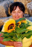 Mature woman flowers Royalty Free Stock Photo