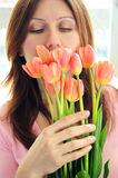 Mature woman with flowers Royalty Free Stock Image