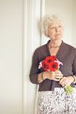 Mature Woman with Flowers Posing Royalty Free Stock Photo