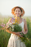 Mature woman with flowers posy. Outdoor portrait of   mature woman with flowers posy Stock Photo