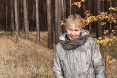 Mature woman in the forest Royalty Free Stock Photos
