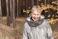 Mature woman in the forest Stock Photo