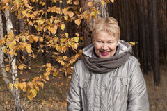 Mature woman in the forest Royalty Free Stock Photo