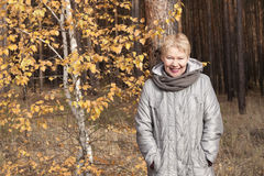 Mature woman in the forest Royalty Free Stock Images