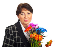 Mature woman with fresh flowers Stock Photo