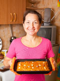 Mature woman  with fresh  honey cake Stock Image