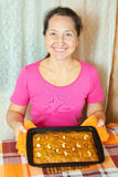 Mature woman  with fresh  honey cake Stock Photos