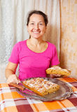 Mature woman  with fresh  honey cake Royalty Free Stock Photography
