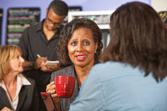 Mature Woman with Friend in Cafe Stock Image