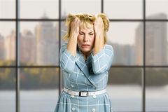 Mature woman in full desperation. Royalty Free Stock Photo