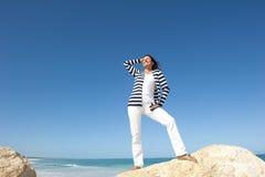 Mature woman fun ocean holiday Royalty Free Stock Photos