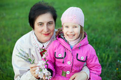 Mature woman and funny little girl Stock Photo