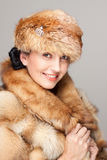 Mature woman in fur hat portrait stock photography