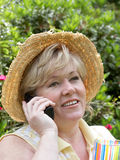 Mature woman in the garden Royalty Free Stock Image