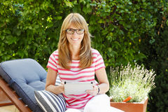 Mature woman in garden Stock Photos