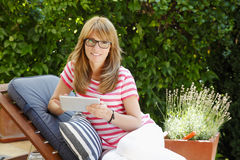 Mature woman in garden Stock Images