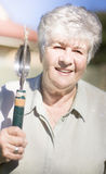 Mature Woman With Garden Tool Royalty Free Stock Photo