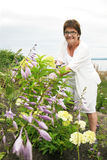 Mature woman gardening stock photo