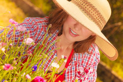 Mature woman gardening in her backyard Stock Image