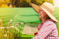Mature woman gardening in her backyard Stock Images