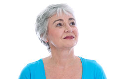 Mature woman gazes serenely into their future - isolated on whit Stock Photo