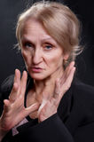 Mature woman gesticulate. Mature woman dressed in suit gesticulate royalty free stock photo