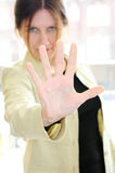 Mature woman gesturing stop. With palm of her hand Royalty Free Stock Images