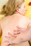 Mature woman getting back massage Stock Image