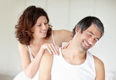 Mature woman giving a  massage to her husband Royalty Free Stock Photos