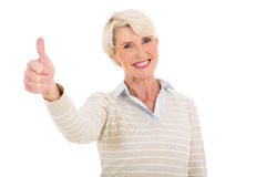 Mature woman giving thumb up Royalty Free Stock Images