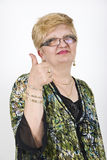 Mature woman giving thumbs up royalty free stock photos
