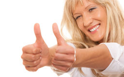 Mature woman giving thumbs up sign isolated Stock Photos