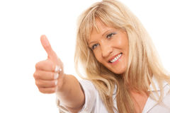 Mature woman giving thumbs up sign isolated Royalty Free Stock Photos