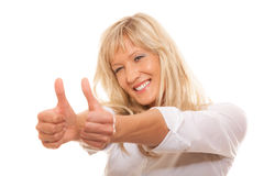 Mature woman giving thumbs up sign isolated Stock Photo