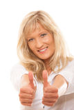 Mature woman giving thumbs up sign isolated Royalty Free Stock Images
