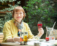 Mature woman  with  glass of red wine Royalty Free Stock Photos