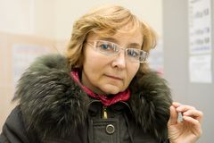 Mature woman in glasses Royalty Free Stock Photo