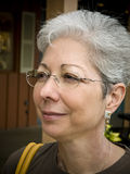 MAture woman in glasses 27. Photo image of a mature gray haired woman in profile with glasses Stock Photos