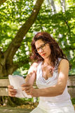 Mature woman with glasses reads paper Royalty Free Stock Images