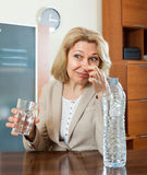 Mature woman with grass of poor quality water Stock Photography