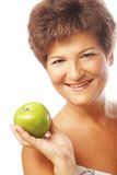 Mature  woman with green apple Stock Images