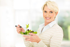 Mature woman green salad Royalty Free Stock Photo