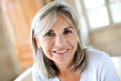 Mature woman with grey hair looking at camera Stock Image