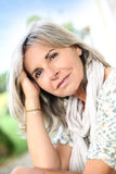 Mature woman with grey hair outdoor Stock Image