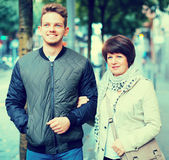 Mature woman and guy taking walk Royalty Free Stock Photo