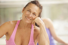 Mature woman in gym class. Mature women relaxing in gym class Stock Image